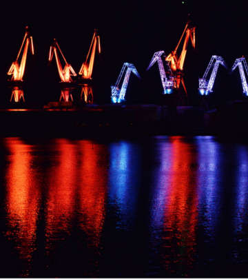 Cranes in the seafront at Pula, Croatia nicely lit with Philips outdoor lighting