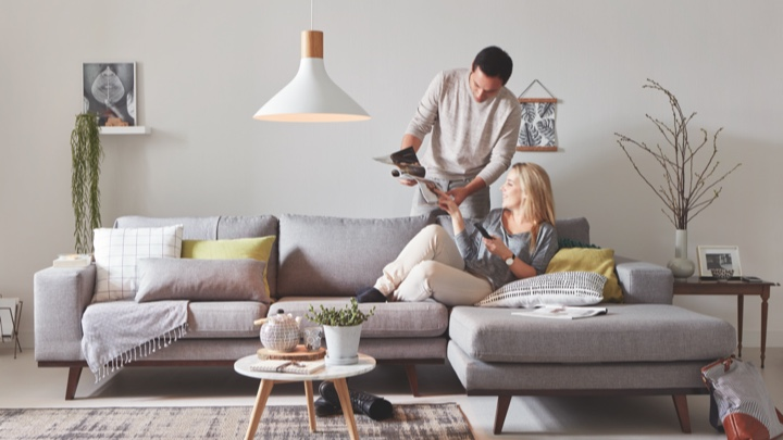 Bright living room with man and woman