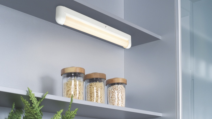 Clip-on lamp in a storage closet