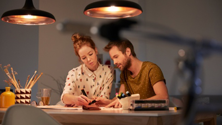 two people creating a light plan at a well lit desk